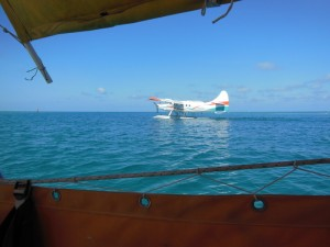 A seaplane lands nearby - Tortugas anchorage